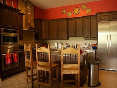 Gourmet kitchen-granite counters, full pantry, oven, warming drawers, gas stove