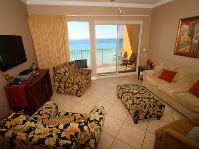 Living room with pull out couch balcony access and spectacular gulf view.