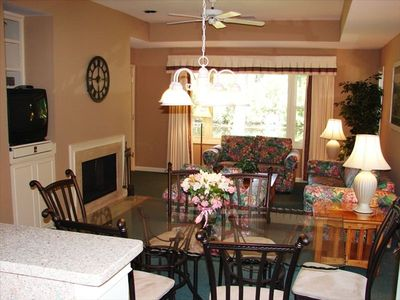 A spacious living and dining room - flat screen tv - fireplace-deck access.