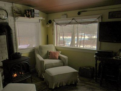 So warm and inviting! Enjoy the peaceful river views right outside your window!