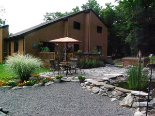 Bushkill chalet photo - Back patio, hot tub, and pond