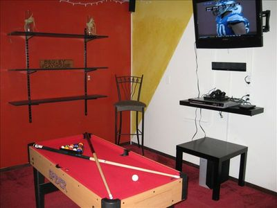 Game room with darts, multi-game table, TV, stereo, video games