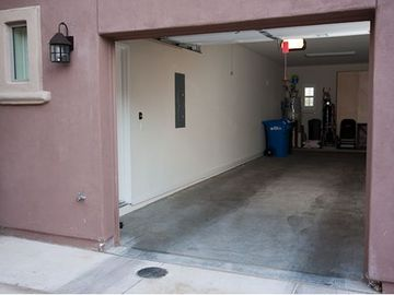 Our tandem garage that can accomodate two vehicles. The garage enters the condo.
