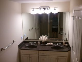 Belmont Towers Ocean City condo photo - Dual Sink in Master Bath large shower stall visible in mirror