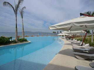 Nuevo Vallarta condo photo - Gorgeous, huge pool, just above the sandy beach.