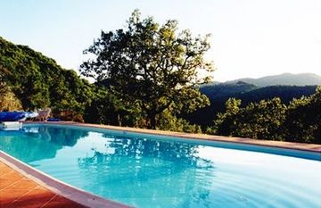 The pool is hidden from the house, with views over the Chianti Hills.