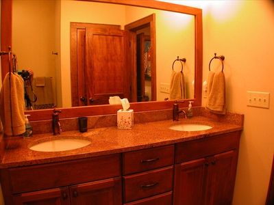 In addition to this full bath with shower, there is a convenient half bath