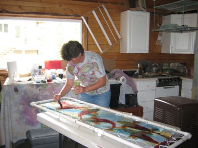 Chickaloon cabin rental - Your host Wendy working on a silk painting in her studio nearby....