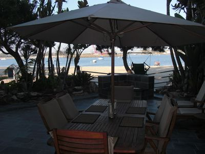 Dine on the Beach Front Patio with Gas Grill.