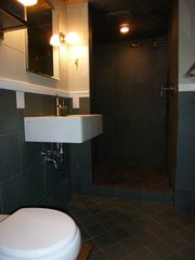 Slate Bathroom with large shower and new, thick towels. - Saratoga Springs apartment vacation rental photo