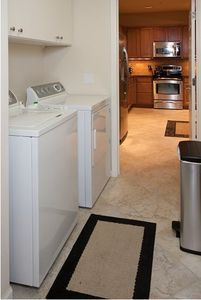 The view as you enter from the garage through the laundry room into the kitchen.