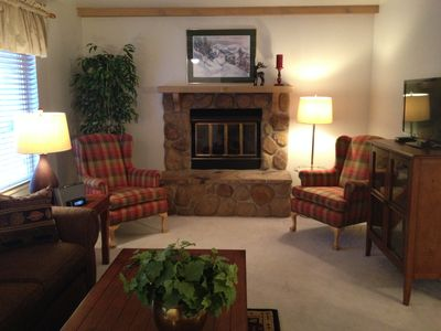 Living room with gas fireplace and queen sofa sleeper