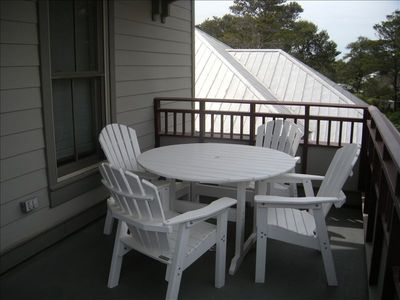 Outdoor porch with dinette.