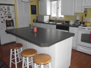Bolton Landing house photo - Kitchen with seating for four at island counter