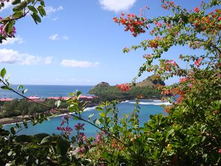 Gorgeous Day: view of Sandals Grand & Pigeon Island from Ti Zan - Cap Estate villa vacation rental photo