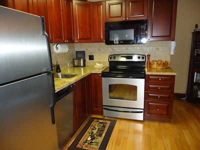 Lovely kitchen with stainless appliances and granite counters
