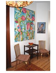 Newport house photo - 1960's Italian wicker chairs, owner's original artwork and rolling guerdon table