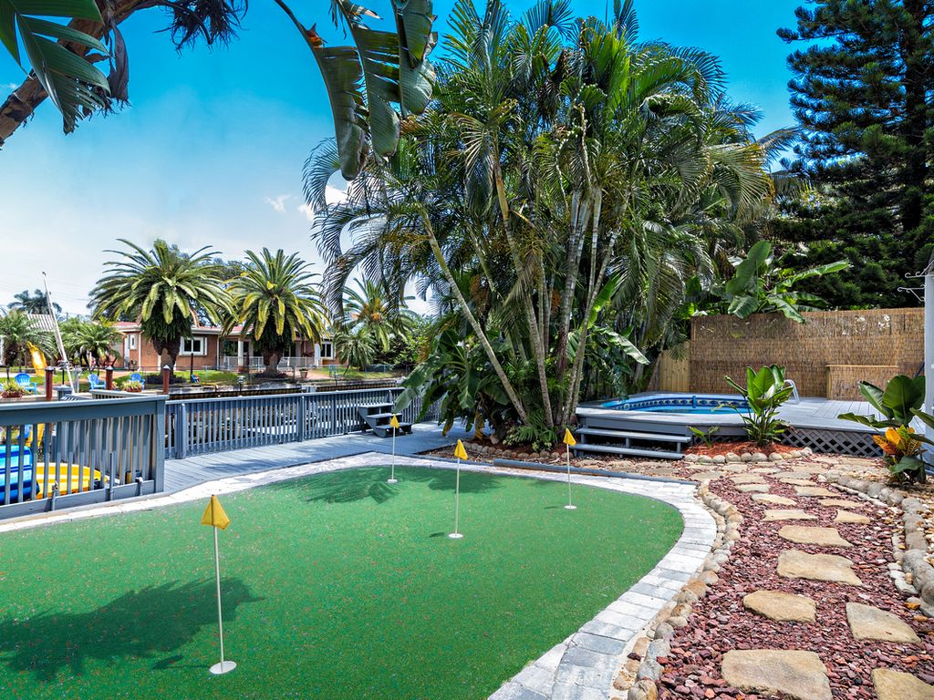 private backyard with a pool putting green 2 kayaks bbq 70 ft of