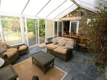 The conservatory leads to the patio area