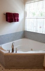 Bastrop house photo - a jetted tub for a relaxing evening