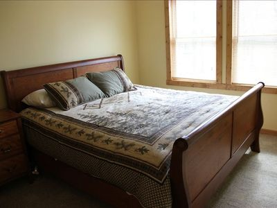 King sleigh bed in one of the upstairs bed rooms.