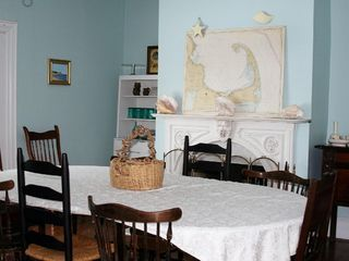 Plymouth house photo - Blue dining room with marble fireplace seats 20