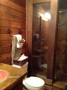 Cherry Log cabin rental - Rock tile bathroom shower and copper sink