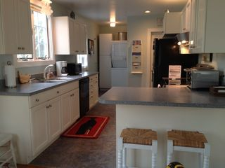 kitchen: w/ elec stove top/oven, microwave, toaster/convection oven, dishwasher