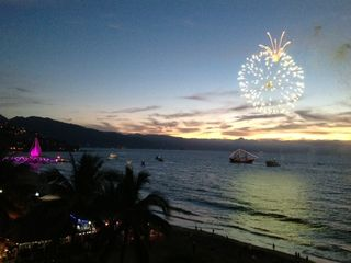 Puerto Vallarta condo photo - Night view from balcony of the Los Muertos pier and fireworks