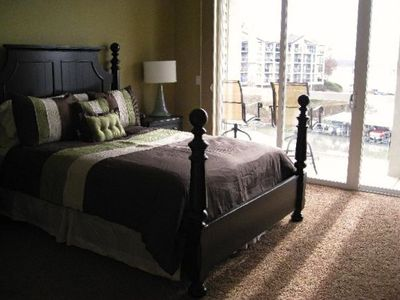 The queen bed in the master suite offers plenty of comfort with a great view.