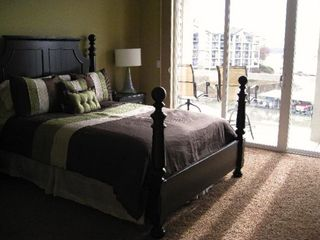 Osage Beach condo photo - The queen bed in the master suite offers plenty of comfort with a great view.