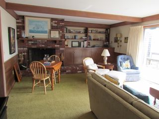 Pocasset house photo - Living room corner with brick fireplace, game table