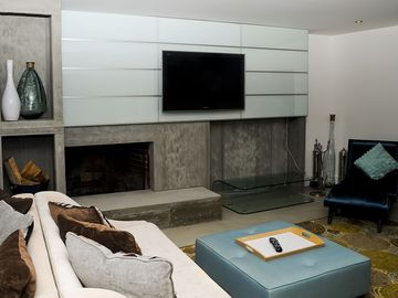 Totally renovated living room with fireplace and wall mounted TV
