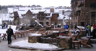 The Ritz Carlton Bachelor Gulch Hotel terrace and Club in the background.
