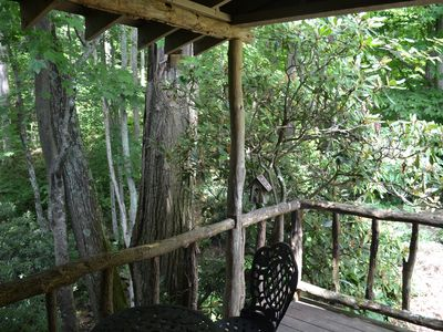 Porch overlooks creek & fully wooded hillside where you can't see another house