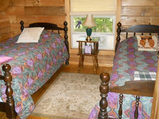 Green Lake cabin photo - Loft bedroom has skylight and built-in drawers and shelves