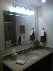 Upstairs Master Bath with plenty of lighting - Indian Shores condo vacation rental photo