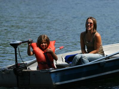 Wilmington house rental - Learning to drive the electric boat. Not very fast; safe for kids.