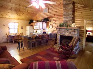 Branson cabin photo - Upstairs living area with fireplace open to kitchen so even the cook can visit!