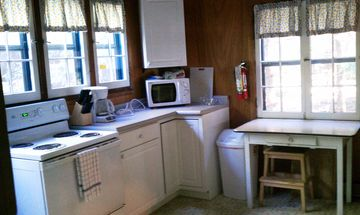 Roomy kitchen-plenty of prep space and a view to the large back deck and yard
