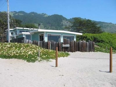 Front of home with seasonal roped in private beach area.