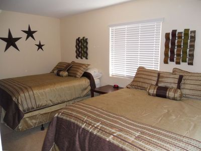 Two comfortable queen sized beds with large walk in closet.