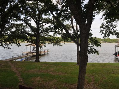 Over 100 ft of lake front with a pier and boat house!