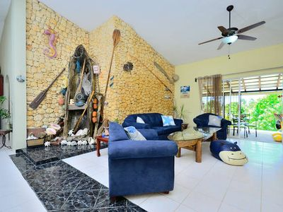 Living Room - Decorated With Real Boats and Direct Access To Covered Terrace