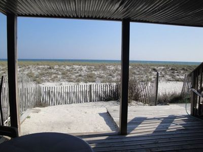 View of the Gulf over the white sand dunes from the covered patio