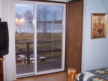 Second Upstairs Bedroom View of the Lake with Sliding Glass Doors to Deck