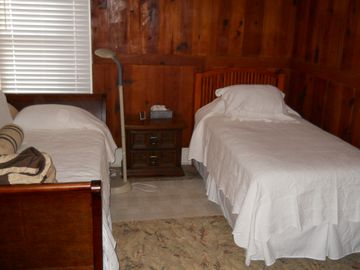 Twin beds in second bedroom.