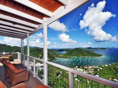 Sip coffee and enjoy the sunrise from your private balcony overlooking Coral Bay