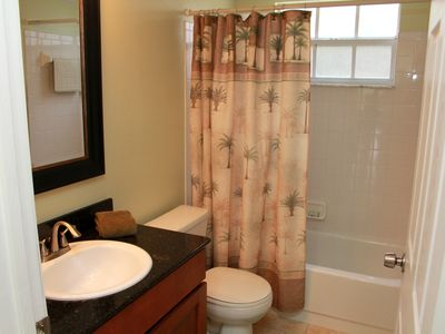 Hall Bathroom with Tropical Shower Curtains w/ New Cabinets/Mirror and New Counter Top.