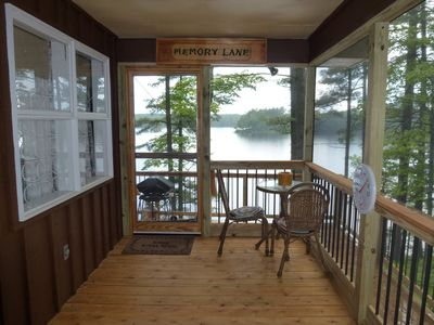 Screened-in side porch & view of lake